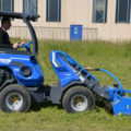 flail mower attachment for mini loader in action